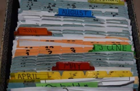 Close up view of a file drawer with multiple tabs for each month