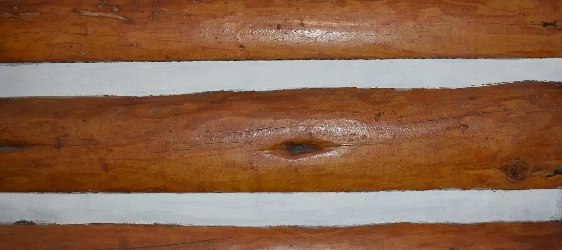 Close up view of a cabin's log walls